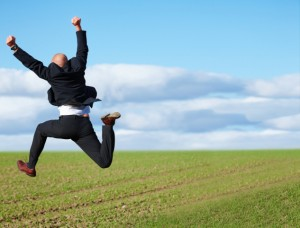 856725-yes-successful-business-man-jumping